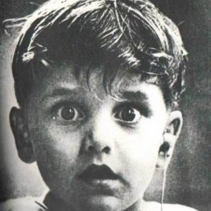 boy hearing for the first time (w hearing aid)